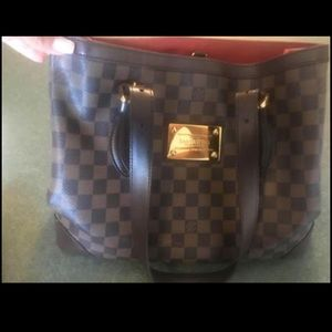 Louis Vuitton Hempstead bag.